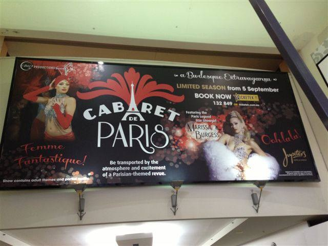 Huge Billboard goes up in Robina Town Centre announcing Cabaret De Paris at Jupiters Hotel and Casino